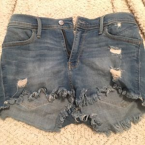 High-waisted distressed jean shorts.